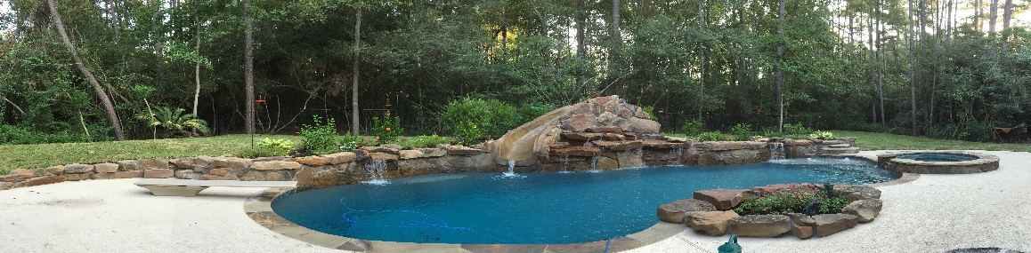 gunite__slide_raised_wing_wall_scupper_conroe_swimming_pool_builder_kuykendallpools.jpg