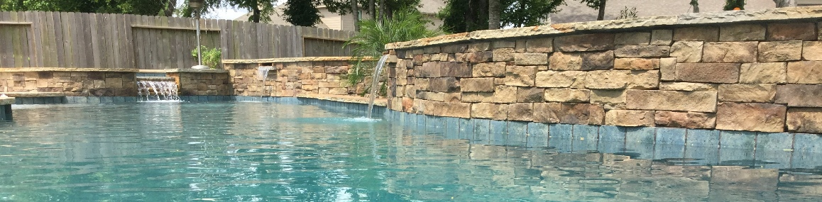 raised_wall_scupper_conroe_swimming_pool_builder_kuykendallpools.jpg